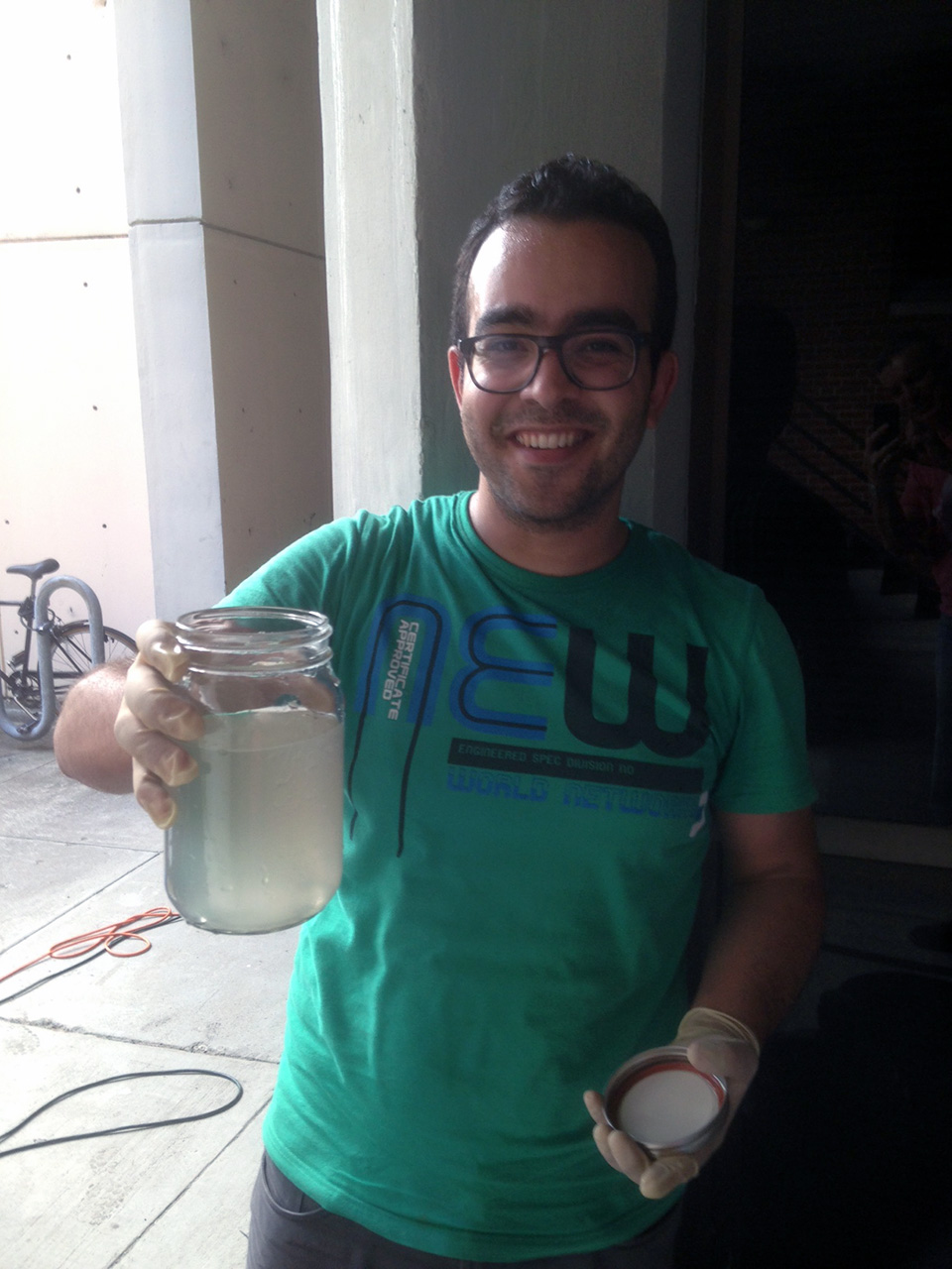 Sherif Elsayed is showing the effluent of dog poop slurry (a surrogate for human fecal sludge) treated in our supercritical water oxidation prototype (June 2016)