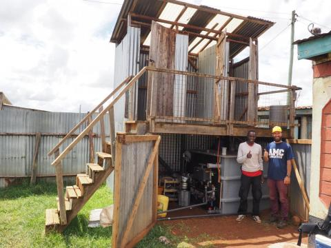 One of our Anaerobic Digestion Pasteurization Latrine (ADPL) prototype (here North unit in Eldoret, Kenya with Aaron and local worker)